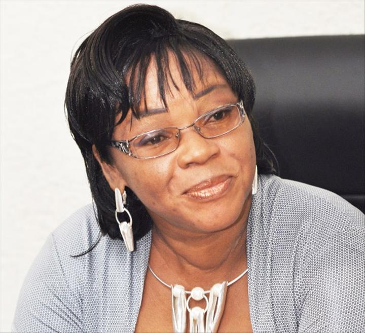 Madame Marie-Laurence SRANON SOSSOU, Ministre de la Famille, des Affaires Sociales, de la Solidarité Nationale, des Handicapés et des Personnes de Troisième Age